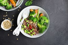 Red fragrant rice with soybeans, broccoli, baby carrots, spinach, pine nuts. Top View. Royalty Free Stock Photos