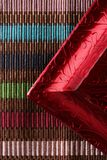 Red frame corner over multi color tablecloth Stock Images