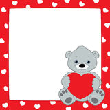 Red frame gray teddy square. Vector red frame with hearts pattern. Gray teddy bear sitting in the lower right corner and holding heart symbol. Place for text on Royalty Free Stock Image