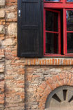 Red frame window on a brick wall Stock Photography