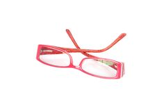 Red framed spectacles. Isolated modern red framed spectacles Royalty Free Stock Photography