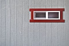 Red Framed Window. On Grey Wooden Wall Royalty Free Stock Photo