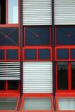 Red-framed windows. Detail of façade of modern office building Stock Images
