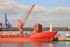 Red freighter in harbor Stock Images