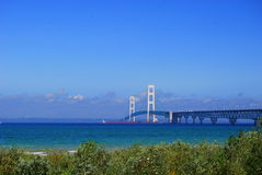 Red Freighter Under the Mighty Mackinac Bridge Stock Image