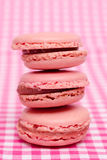 Red french macarons with strawberries Stock Images