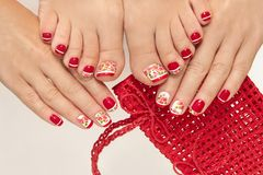 Red French manicure. Red French manicure with design of roses on a white background royalty free stock photos
