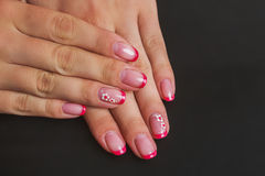 Red french nail art with flower Royalty Free Stock Image