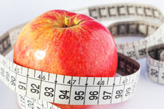 Red fresh apple and measure tape. diet concept Stock Photography