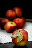 Red fresh apples. On the openwork napkin Stock Photos