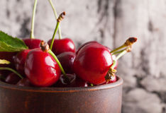 Red fresh cherry in cup Stock Photos