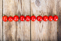 Red Fresh Cherry Tomato on Wooden Rustic Background Royalty Free Stock Photos
