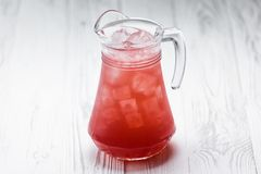 Red fresh homemade lemonade drink in a jar royalty free stock photo