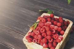 Red fresh raspberries basket on brown rustic wood background. Red fresh raspberries on brown rustic wood background, copy space Stock Photography