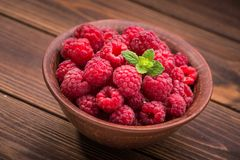 Red fresh raspberries. On rustic wood table Stock Photography