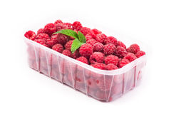 Red fresh raspberry in basket isolated. On white background Royalty Free Stock Image