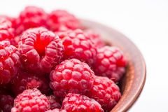 Red fresh raspberry in bowl Stock Images
