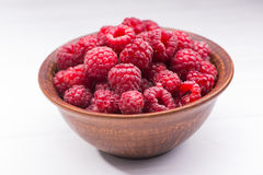 Red fresh raspberry in bowl Royalty Free Stock Images