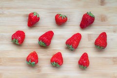 Red fresh strawberries on bamboo board Stock Images