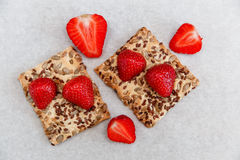 Red Fresh Strawberries are on the Cracker with Grains on the White Paper.Breakfast Organic Healthy Tasty Food.Cooking Vitamins Ing Stock Images