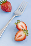Red fresh strawberries and a fork Stock Images