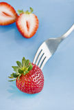 Red fresh strawberries and a fork Royalty Free Stock Photos