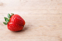 Red fresh strawberry fruit on wooden table. Stock Photography