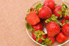 Red fresh strawberry in glass vase Stock Image