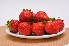 Red fresh strawberry on plate Royalty Free Stock Images