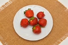 Red fresh strawberry on plate Royalty Free Stock Image