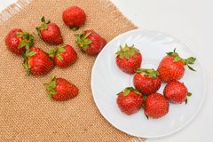 Red fresh strawberry on plate Stock Photos