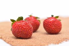 Red fresh strawberry on sacking Royalty Free Stock Images