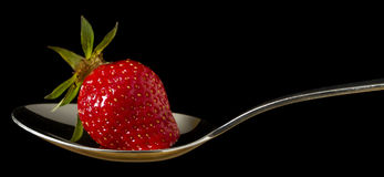 Red,fresh strawberry on spoon Royalty Free Stock Image