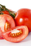 Red fresh tomato with cut. On white background stock photo