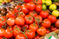 Red tomatoes on branch in wicker baskets on counter stock photos