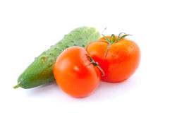 Red fresh tomatoes with cucumber Stock Images