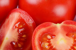 The red fresh tomatoes cut. Macro Royalty Free Stock Photography