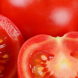 The red fresh tomatoes cut. Macro Stock Photos