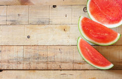 Red and fresh watermelon on wooden table stock photography