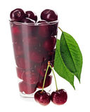 Red fresh wet cherry fruits in transparent glass. Isolated on white Stock Photo