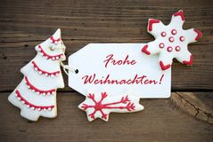 Red Frohe Weihnachten on a white Label Royalty Free Stock Images