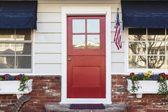 Red front door of an american home royalty free stock photos