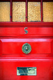 The red front door in England Stock Images