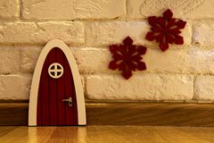 Red front door of a gnome house.  royalty free stock images