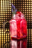 Red fruit cocktail lemonade in vintage jar stock photos