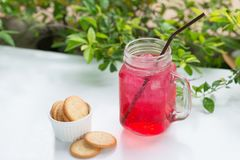 Red fruit flavor soft drink with biscuits. Red fruit flavor soft drink with biscuits stock images