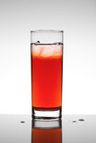 Red fruit juice. Glass of red fruit juice with ice Royalty Free Stock Image
