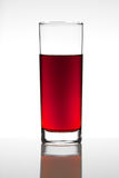 Red fruit juice. Glass of red fruit juice on white background Stock Photos