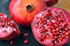 Red fruit Pomegranate on table. Royalty Free Stock Photos