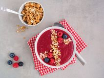 Red Fruit Smoothie Bowl with cereal, healthy breakfast stock photo